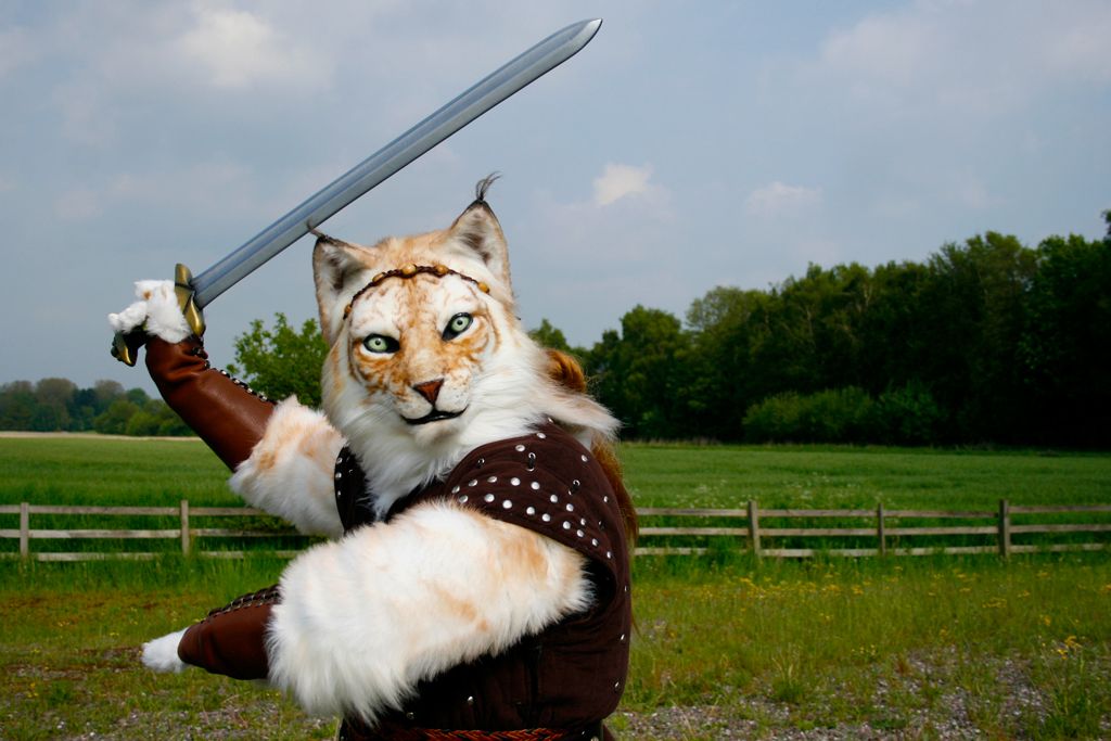 The sword allows for a dramatic pose, while rural background gives sense of correct time period (Mikepaws)